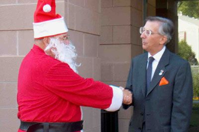 Supervisor Delgaudio walked Santa Claus out of the Leesburg Government Building after his historic visit to warn the Board of Supervisors to leave the lights on for Christmas and to also leave all of Loudoun's Lights alone.
